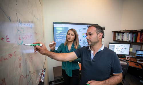 Tijana Radivojevic (left) and Hector Garcia Martin working on mechanical and statistical modeling, data visualizations, and metabolic maps at the Agile BioFoundry last year.